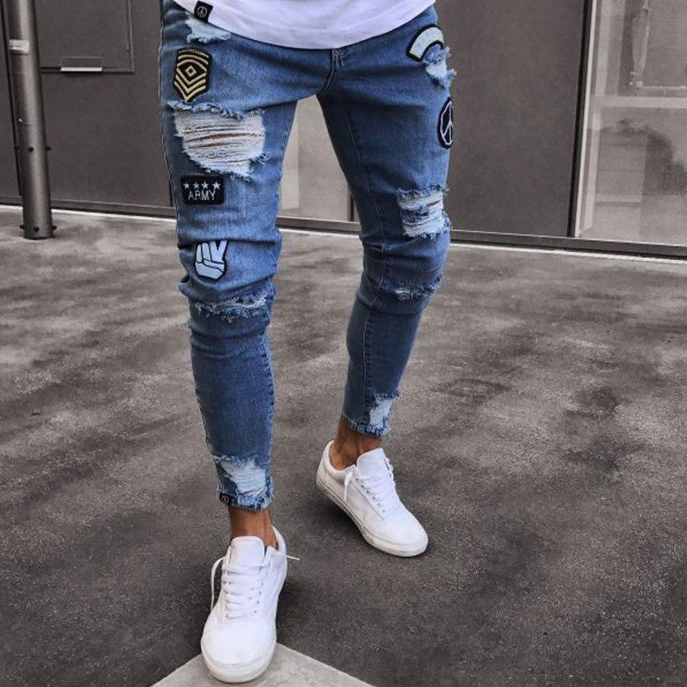 Moomphya New Arrived Distressed Ripped holes Badge men jeans hombre Slim Fit jeans men Hip hop skinny biker jeans streetwear gmancl hole men jeans scratched biker jeans ripped denim straight slim fit hip hop classic rap distressed blue cotton pants