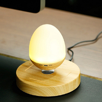 Newest LED Bulb Portable Levitation Bluetooth Speaker Wooden Grain Base Floating Maglev Speaker Egg Shape Night
