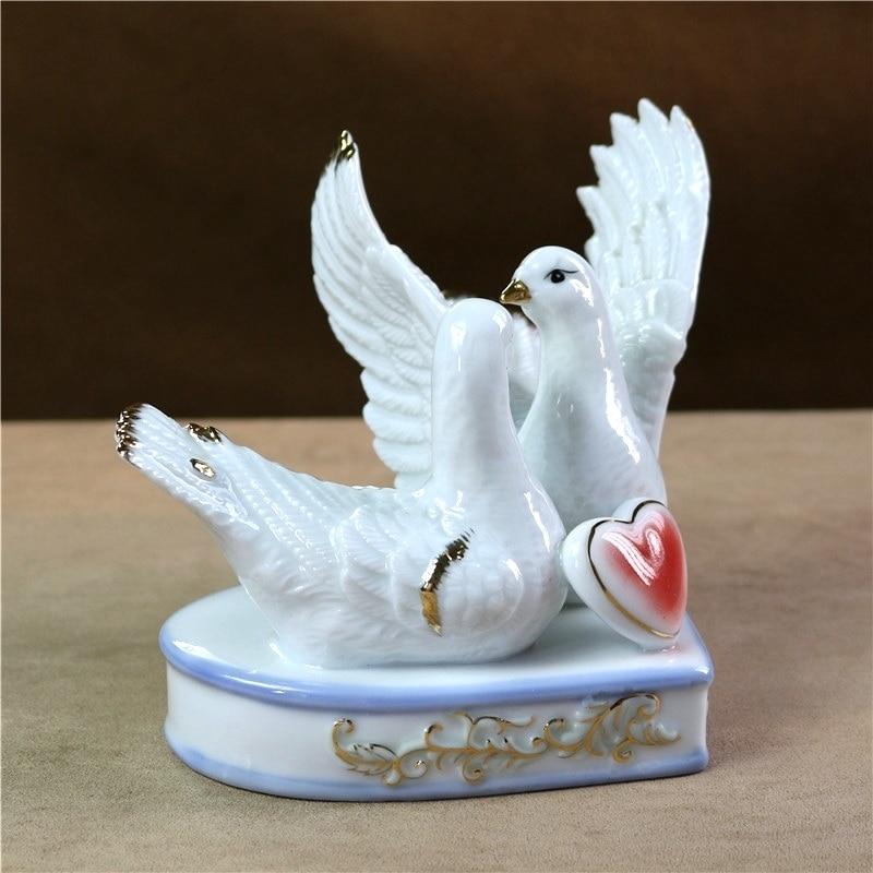 Scultura moderna piuma di uccello in ceramica bianca argento lunghezza 23 cm