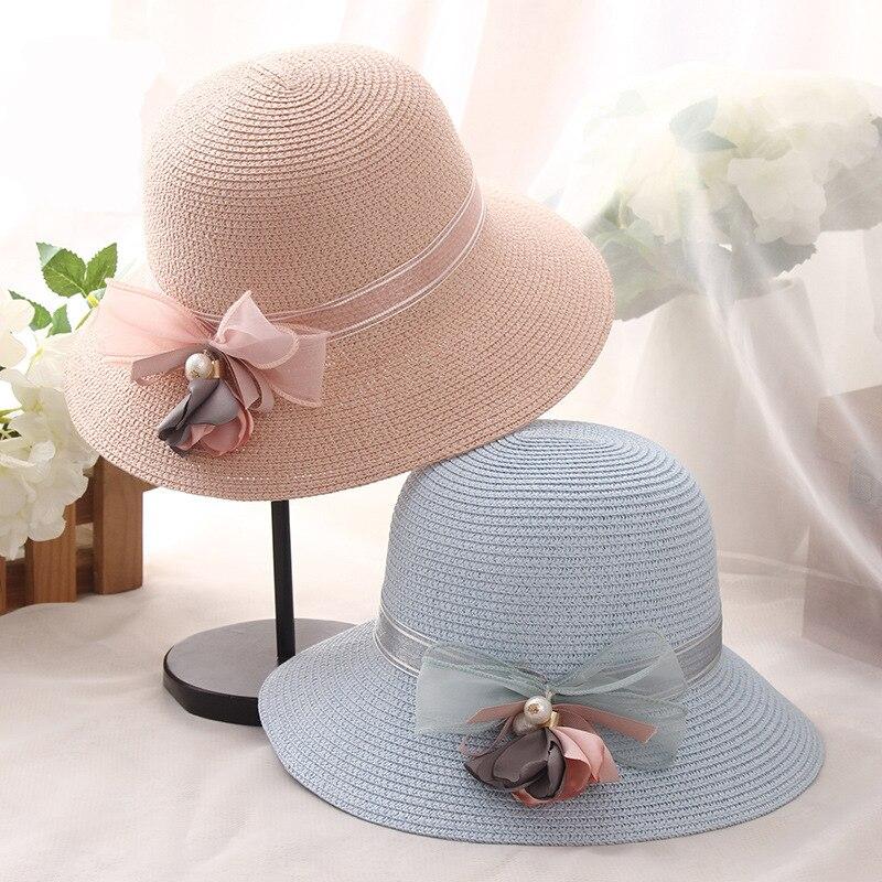 5edb325ce05 HT1156 2017 New Fashion Summer Women Hats Anti-UV Wide Brim Hats Solid  Flower Straw Bucket Sun Hats Ladies Floppy Beach Hats