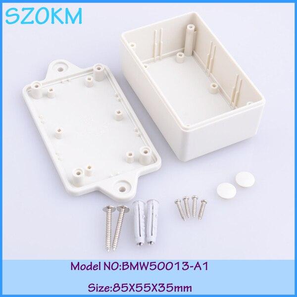 13445cccdb 7 unids lote color gris claro material plástico ABS estándar montaje de  pared de plástico cajas de electrónica para PCB diseño 85x55 x 35mm