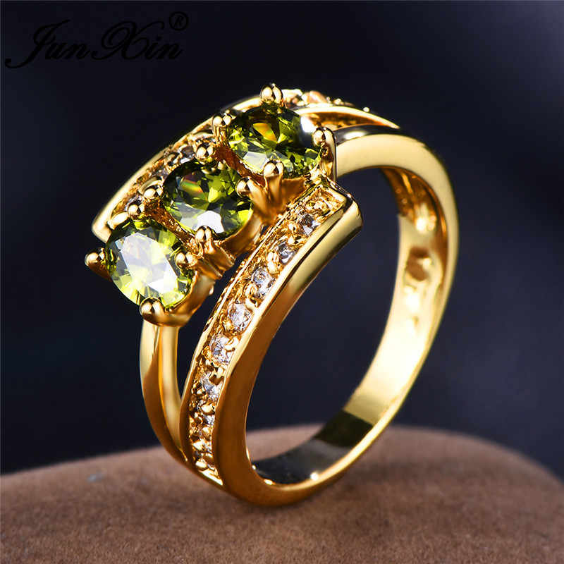JUNXIN Three Oval Stone Olive Green Zircon Engagement Rings For Women Men Yellow Gold Fillled August Birthstone CZ Female Ring