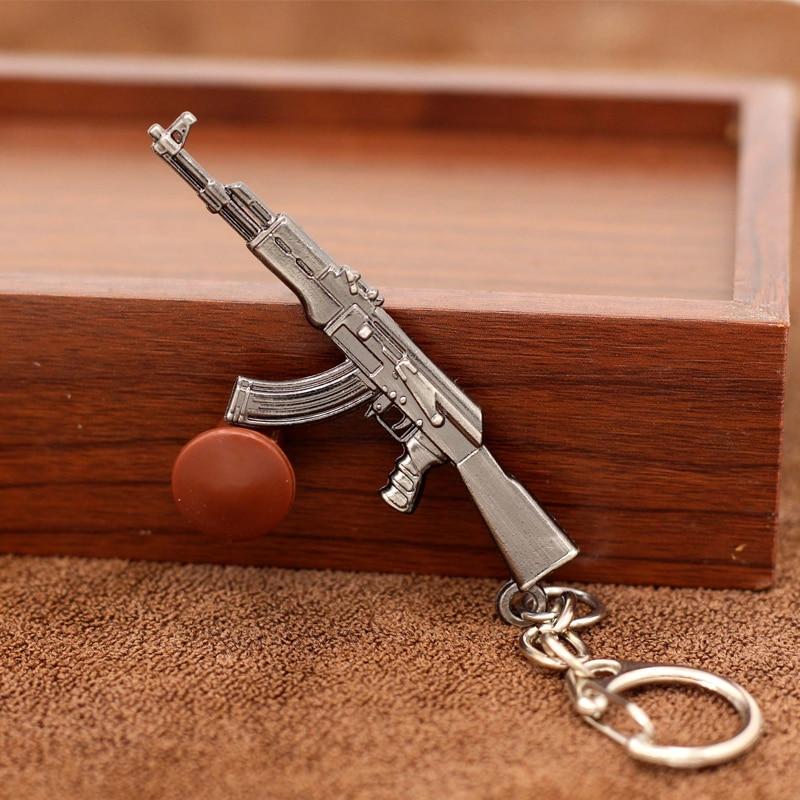 Criativo popular jogos mini ak47 rifle modelo chaveiro armas arma metal chaveiro para unisex homem legal lembrança corrente carro chaveiro