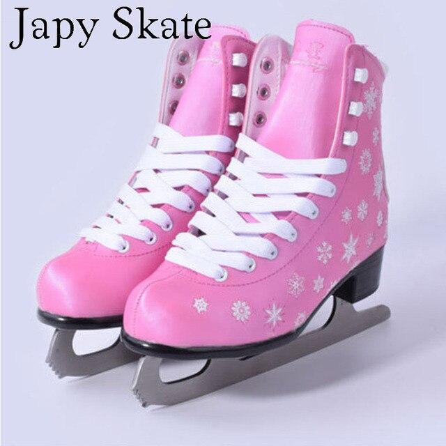 Pink ice skating shoes