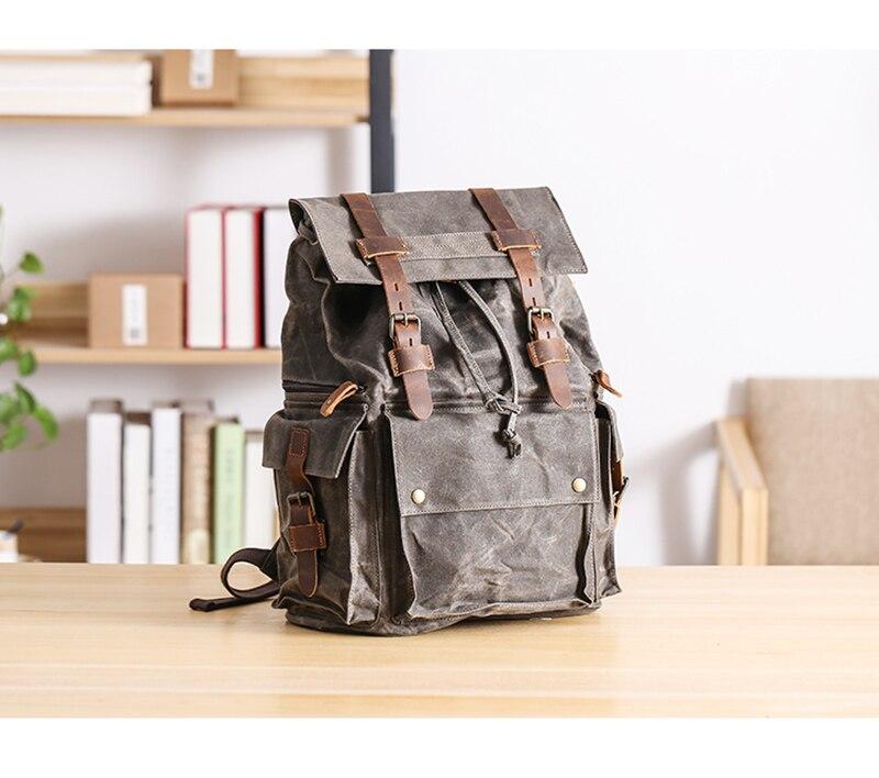black canvas drawsting backpack
