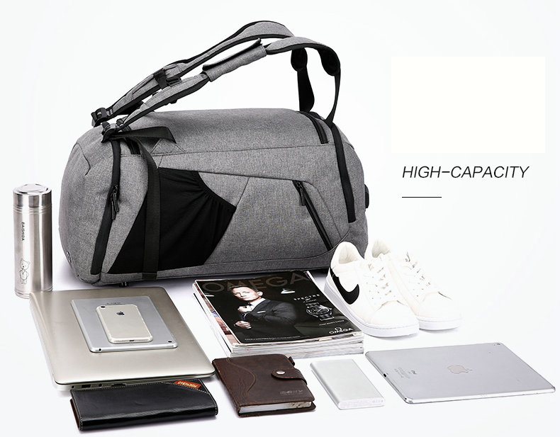 a grey duffle, a laptop, magazines and, books