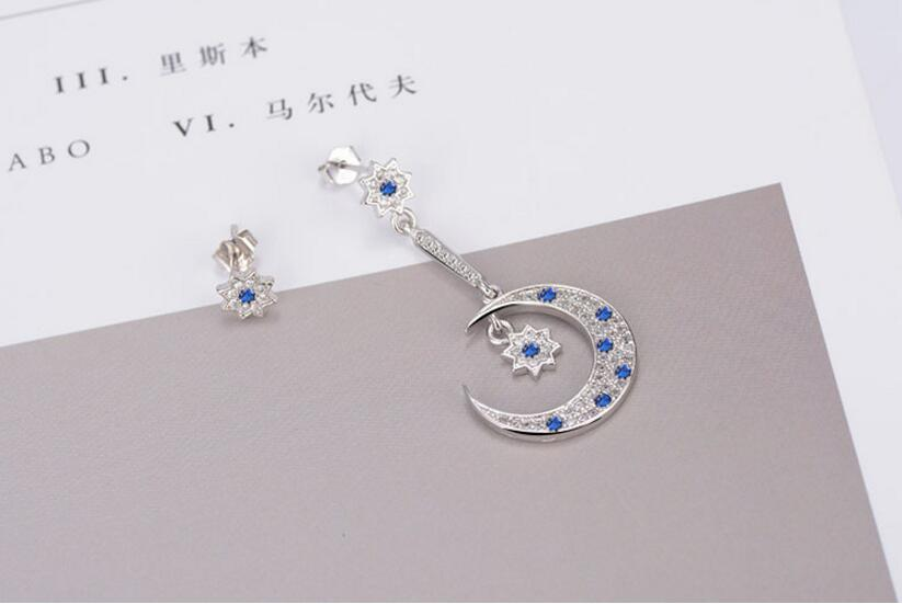 Asymmetrical moon and star earrings jewellery