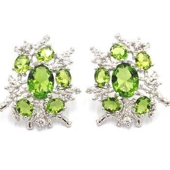 eb233d5dae7b No falso S925 bien pendientes de la joyería de plata de ley 925 mujeres  Esmeralda hecho a mano de moldavita peridoto Rosa Flor de piedra verde