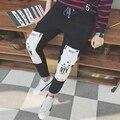 Зима Корейской Штаны для Мужчин Хип-Хоп Шаровары Личность Лоскутная Отпечатано Случайные Длинные Брюки Мужчины 5XL Черный Sweatpant