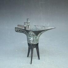 brons ornamenten flessen wijn