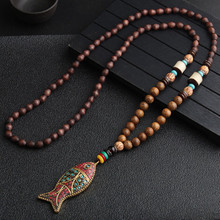 все цены на Retro Bohemian Buddha Wood Beads Long Sweater Chain Ethnic Handmade Nepal Alloy Fish Pendant Necklace for Women Girls Wholesale онлайн