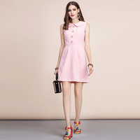 Vestido verano rosa corto sin mangas botón flor 1