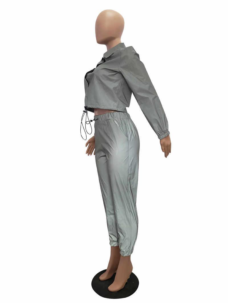 Adogirl 女性セクシー反射トラックスーツナイトバージョンボタンターンダウン襟長袖クロップトップ + カジュアルパンツツーピースセット