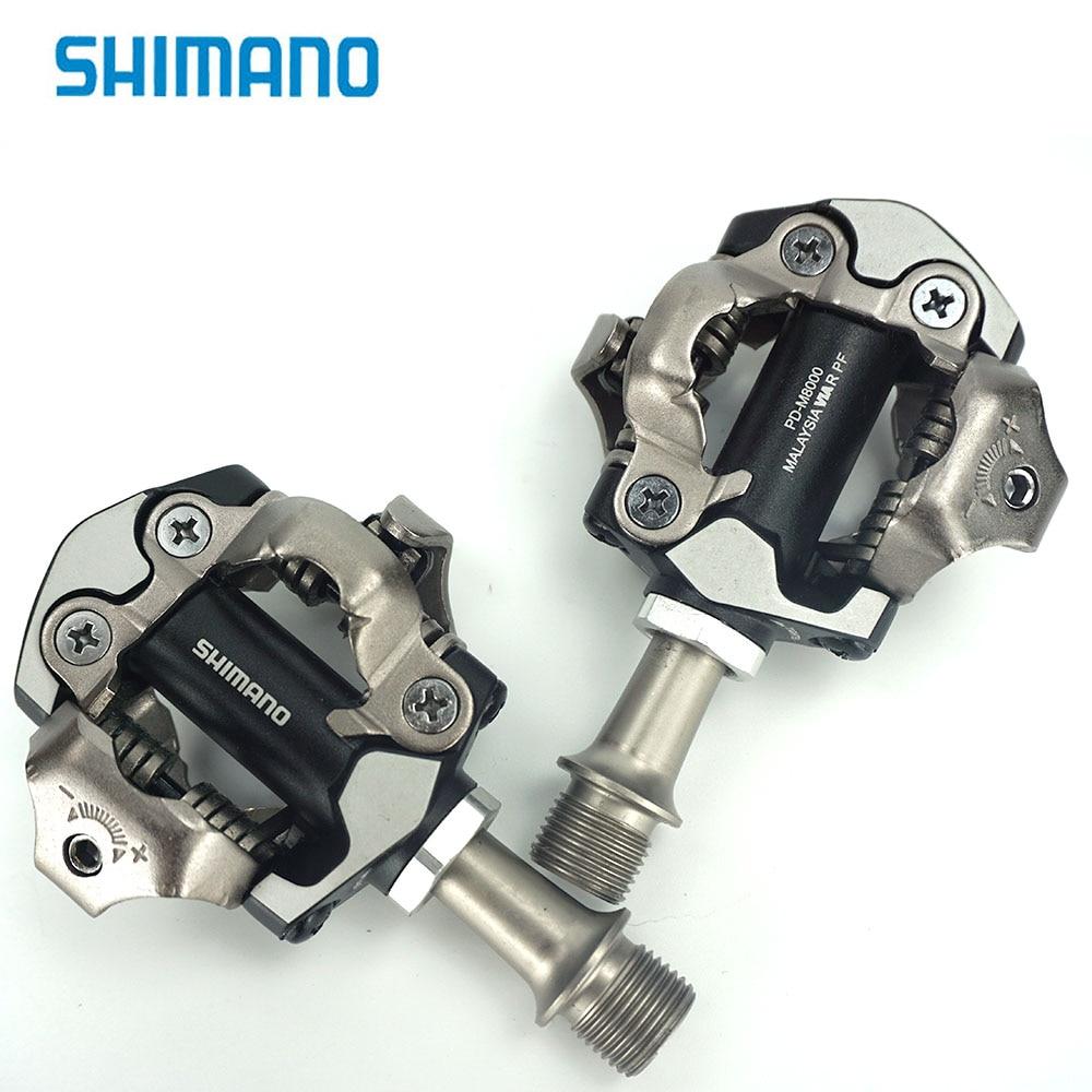 цена Shimano DEORE XT PD M8000 Pedal Self-Locking SPD Pedals MTB Components Using for Bicycle Racing Mountain Bike Parts онлайн в 2017 году