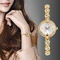 Nuevas Señoras de la Llegada de Lujo Del Rhinestone Reloj de Las Mujeres Relojes de la Aleación de Oro Correa de Reloj de Cuarzo Horas Reloj del relogio Relojes feminino