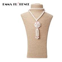 Elegante Estilo Étnico de China Blanco 8mm Tridacna Shell Beads Suéter Cadena Con Colgantes de Loto Pura Demostración de la Mujer Collar de lujo