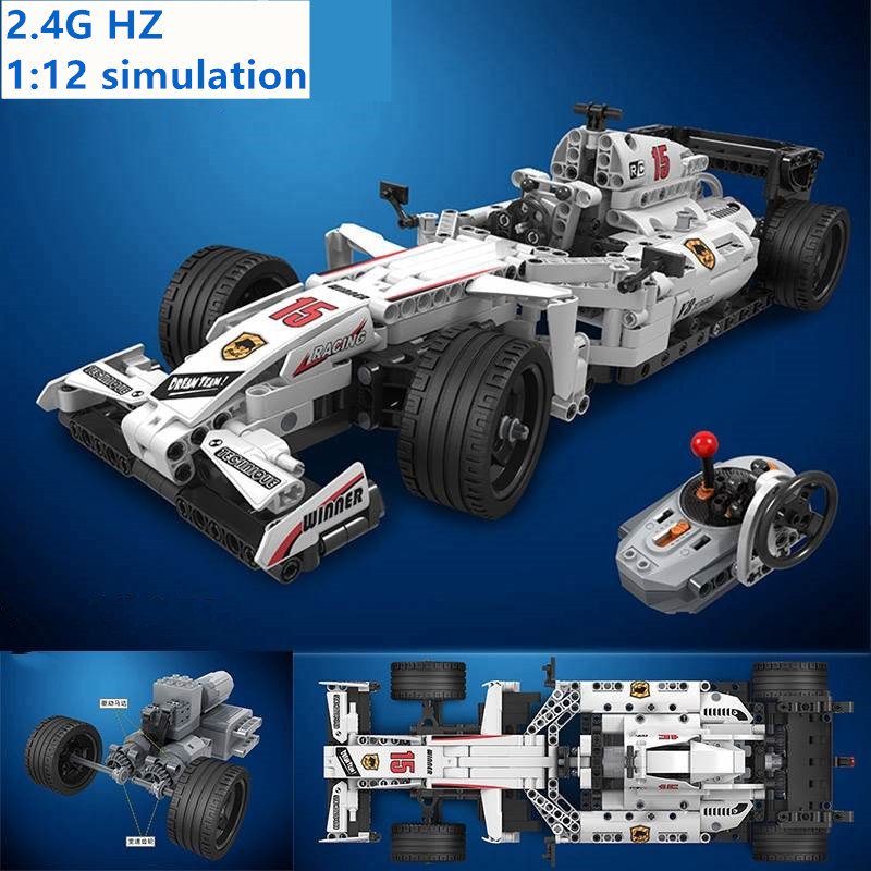729pcs 2.4GHz Technic Remote Control MOC F1 Racing Car With Motor Box Building Blocks Bricks Legoing Creator Toys for Children729pcs 2.4GHz Technic Remote Control MOC F1 Racing Car With Motor Box Building Blocks Bricks Legoing Creator Toys for Children