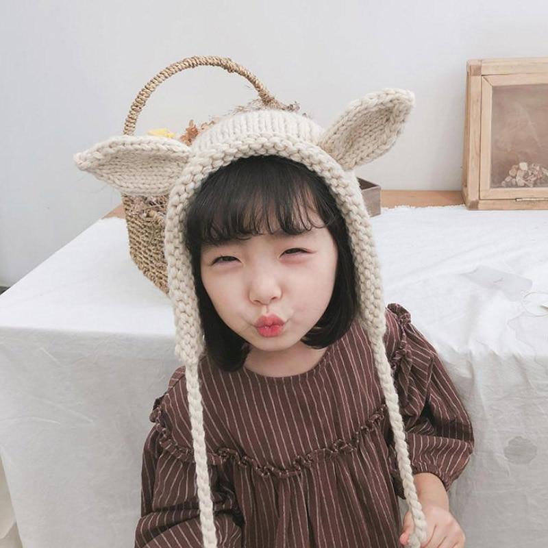 Doitbest 3 a 9 Y niño niña gorros 2018 conejo de dibujos animados dos  orejas lana knit sombreros invierno trenza niño sombrero niños Niñas  Earflap Caps en ... c22929bfd1c