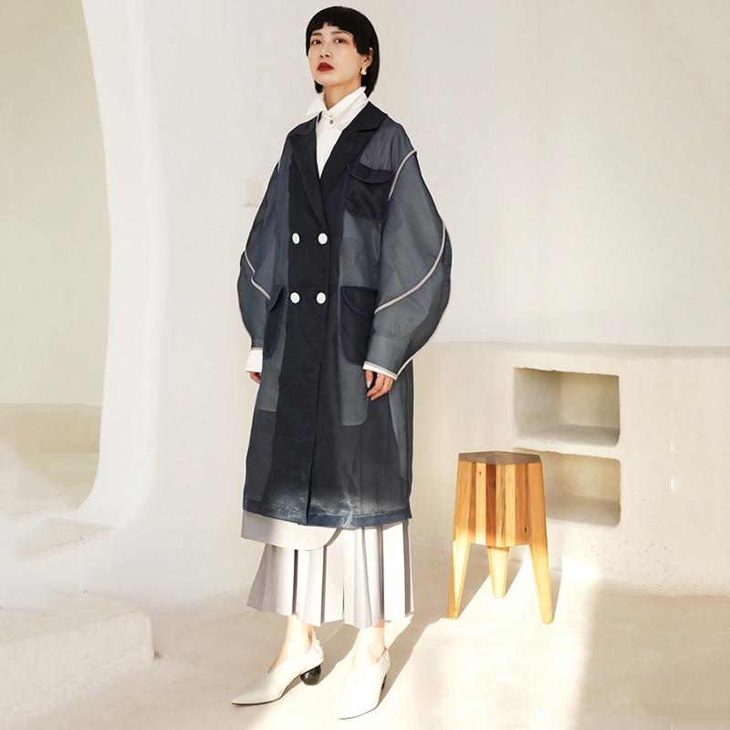 [EAM] 19 New Autumn Winter Lapel Long Sleeve Organza Split Joint Pocket Spliced Windbreaker Women Trench Fashion Tide JR448 7