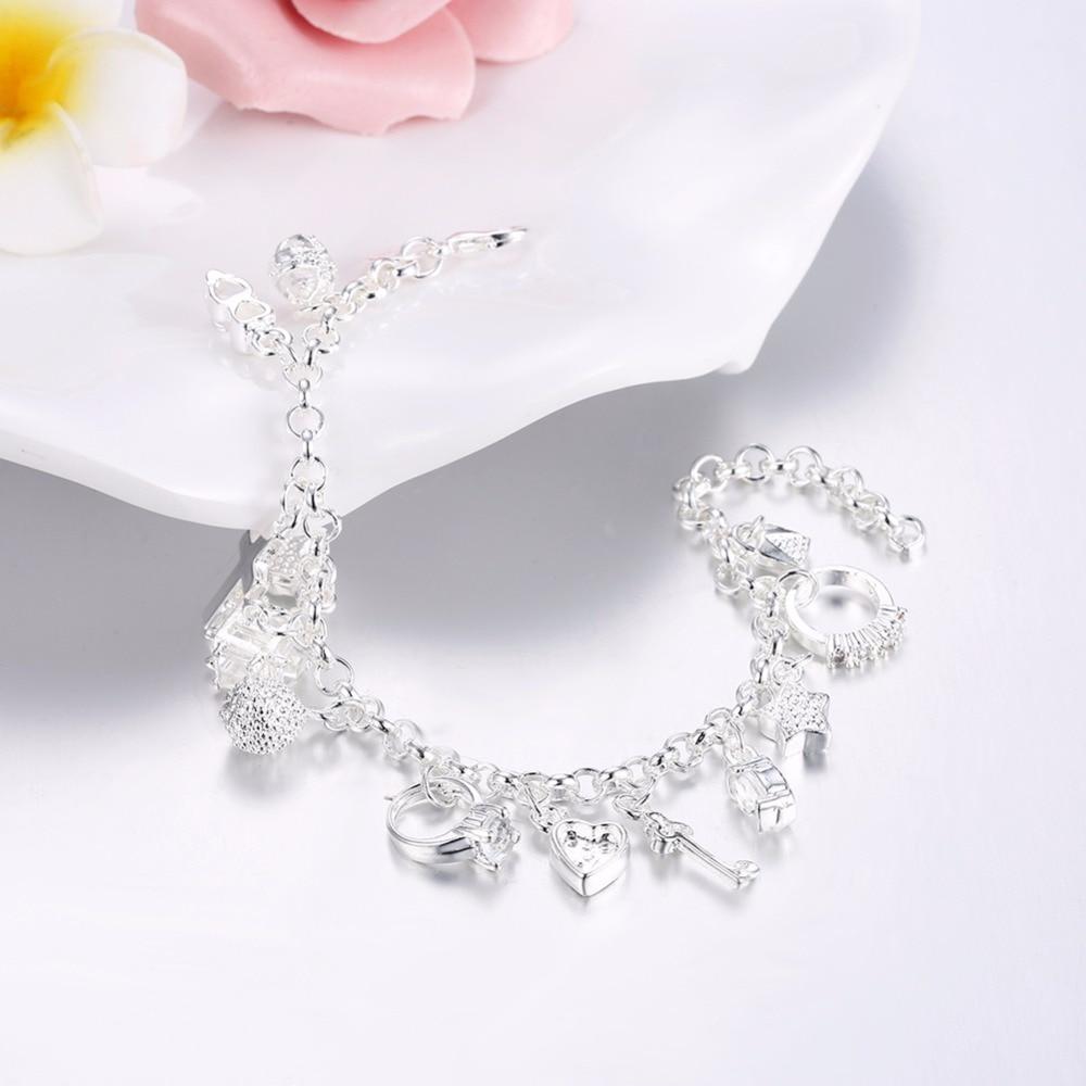 b5ad71190a Joyería de las mujeres de plata pura 925 en 13 encantos dijes de Cruz llave  de bloqueo de corazón estrella Luna flor Zircon brazaletes de pulseras  joyas de ...