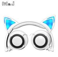 M & J Cartoon הזוהר זוהר מהבהב אוזניות אוזניות אוזן חתול עם אור LED עבור IPhone Sumsang חג המולד תפוח מחשב קופסא מתנה