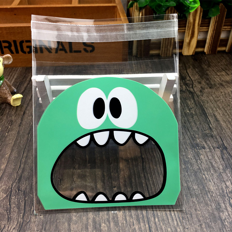50Pcs Christmas Decoration Cute Monster Sharp Teeth Mouth Cookie Candy Plastic Bags Wedding Xmas Gift Packaging Bag Party Favors