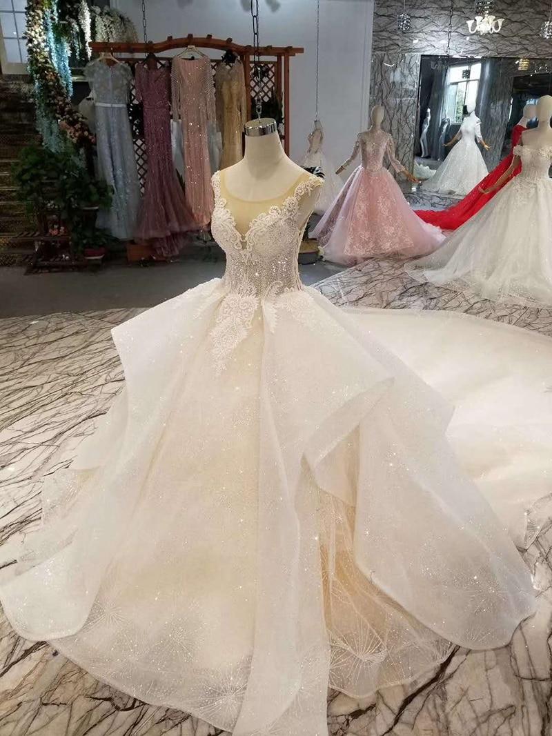 Image 3 - LSS155 luxury shiny wedding dress multi layer skirt o neck sleeveless appliques beauty wedding gown with train free shippingWedding Dresses   -