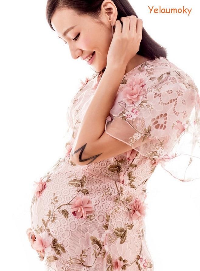 Flor vestido de la playa de manga corta embarazada apoyos de la ...