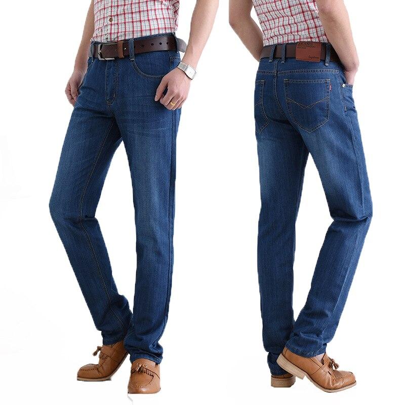 цена на 2017 New Autumn Male Business Jeans Loose Cotton Straight Large Size 38 40 Dark Blue Simple Pants Biker Mens Jeans