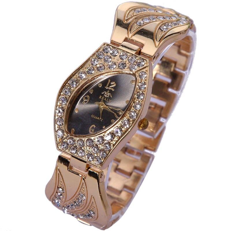 Top Gnova Platinium Rhinestone Metal Angel Feather Bracelet Watch Geneva Style Fashion Women Golden Quartz Wristwatch