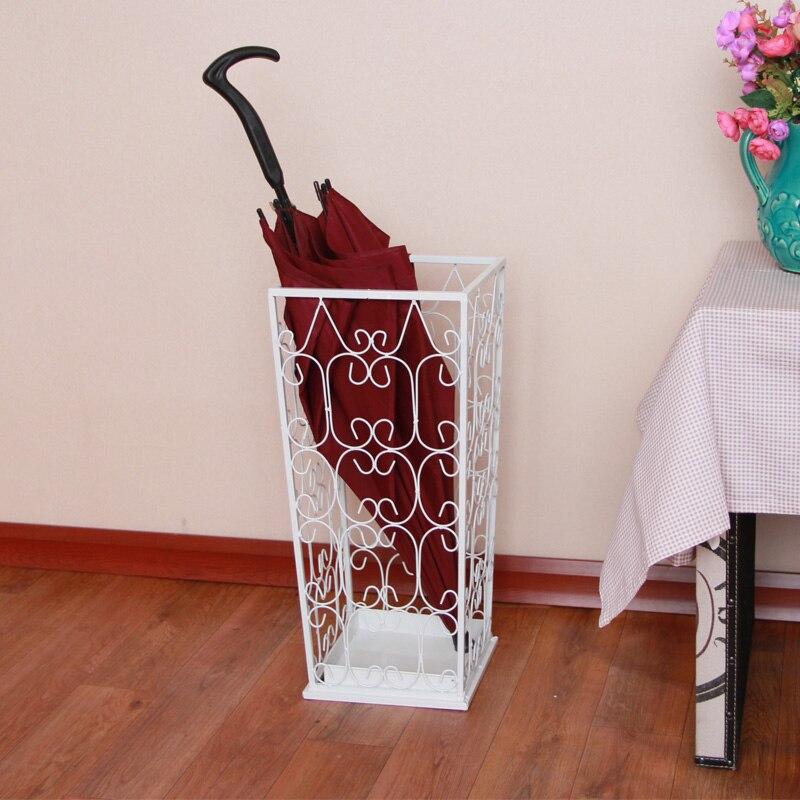 Parapluie en fer forgé se parapluie tube de mode parapluie seau de plancher ménage carré blanc rack de stockage de parapluie