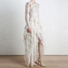 فستان سهرة أنيق بأكمام طويلة وتطريز مميز