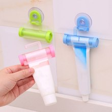 1PC Plastic Rolling Tube Squeezer Toothpaste Dispenser Sucker Holder Dental Cream Bathroom