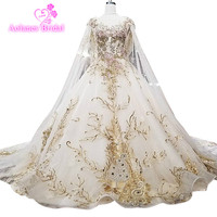 Catthedral Gold Puffy Lace Beading Wedding Dress Aesthetic With Long Cape Ball Gown Long Train Champagne Wedding Dresses 2018