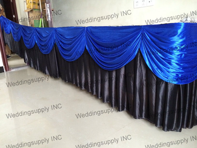 Black Table Skirting With Blue Drape Attached In Table