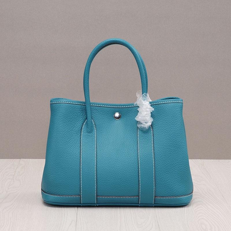 купить PRAVESDA 100% genuine leather tote bags ladies hot sale casual garden bags three size по цене 4595.27 рублей