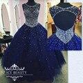 Azul royal sweet 16 vestidos de baile 2017 cheap illusion sheer colher sexy backless cristais bling bling lantejoulas vestidos quinceanera