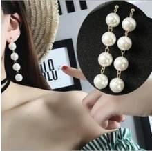 E 143 Korea Fashion Panjang Mutiara Anting-Anting Perempuan Model Besar Rumbai Liontin Mutiara Perhiasan Anting-Anting Tahun Berlebihan Perhiasan ACC(China)