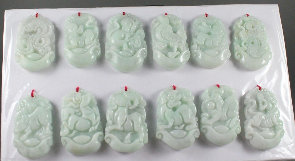 A group of hand-carved twelve Zodiac Pendants made of pure Chinese natural jadeite.A group of hand-carved twelve Zodiac Pendants made of pure Chinese natural jadeite.