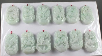 A group of hand-carved twelve Zodiac Pendants made of pure Chinese natural jadeite.
