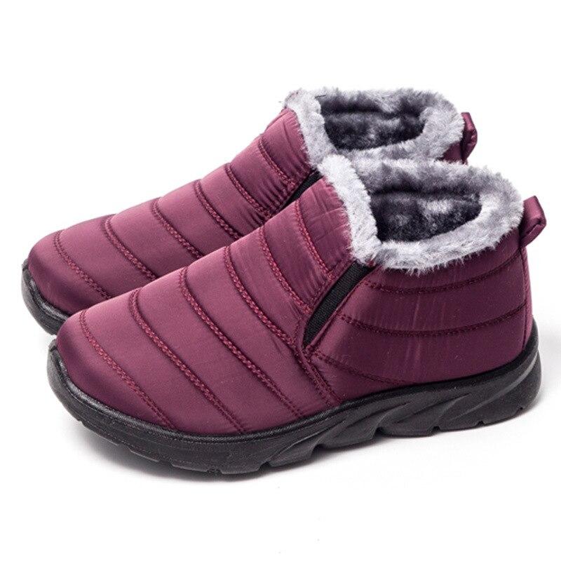 Size36-41 mujeres impermeables zapatos de invierno pareja botas de nieve Unisex piel caliente interior antideslizante inferior mantener calientes botas casuales de madre