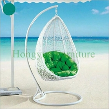 Outdoor rattan garden hammock chair with blue cushions