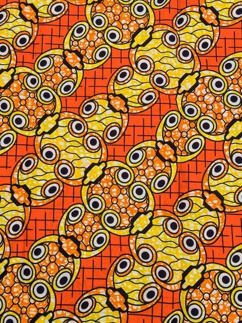 African Textiles Real Wax Orange Yellow Eyes Designs For