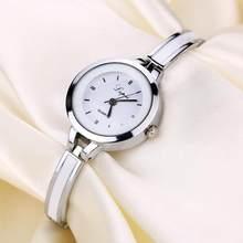 女性クォーツ時計の高級クリスタル鋼ストラップラインストーン女性腕時計レディースブレスレットドレス腕時計レロジオfeminino