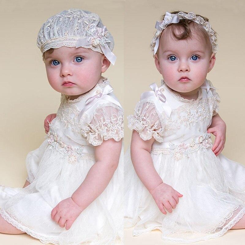 Avec bandeau bébé fille robes nouveau modèle de dentelle blanche et longueur au genou style d'été bébé filles robe bébé fille robes de baptême
