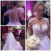 Vestido De Noiva Ball Gown Wedding Dresses Illusion Back Princess Trouwjurk Luxury Pearls Long Sleeve Wedding Dress Casamento