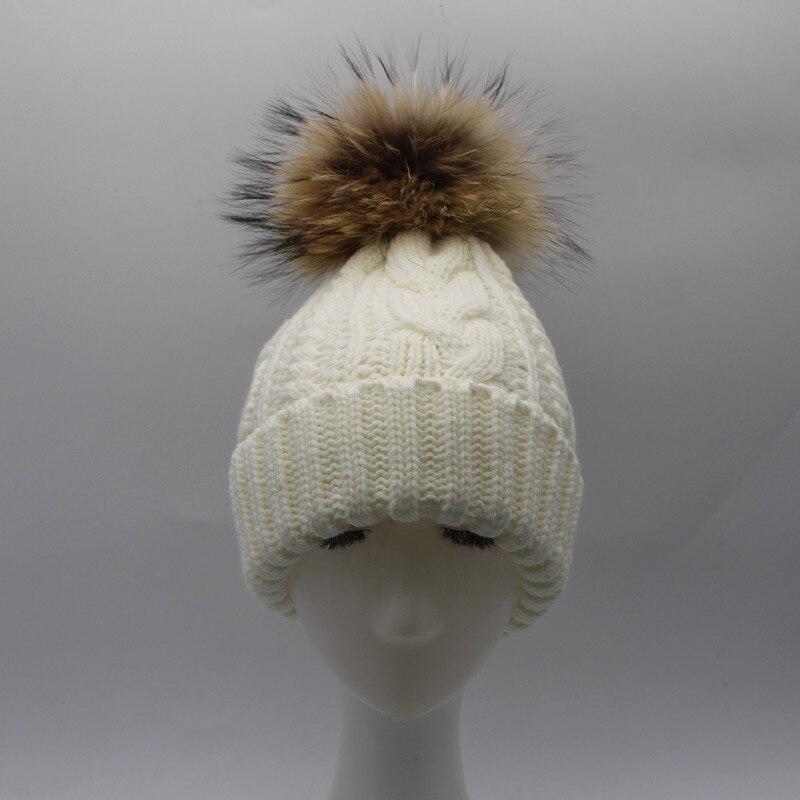 Bonnet intérieur polaire et pompon