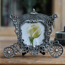 цена на 3 Inch Retro Carriage Shape Photo Frame Newborns Baby Picture Frame Metal Artistic Frames Home Decor Table Ornament Cadre Photo