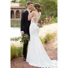 цена на Sexy Mermaid Fit And Flare Crepe Wedding Dress With Lace Cut-Outs Appliques Halter Sleeveless Bridal Gown