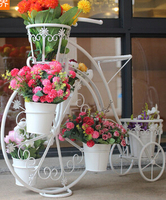 Bicycle florist. Wrought iron layers The balcony floor cosmetic.